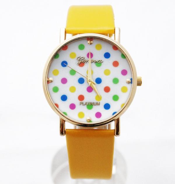 Жълт часовник с цветни точки